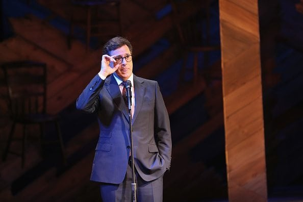 NEW YORK, NY - SEPTEMBER 19: Late Show host Stephen Colbert speaks while serving as emcee at Broadway's Jacobs Theater on September 19, 2016 in New York City. The event, called the United Nations General Assembly at Broadway's Jacobs Theater, showcased performances by The Color Purple, Waitress, Beautiful, and Wicked. The purpose of the event was to continue to raise awareness for the Let Girls Learn initiative, launched by  President Obama and First Lady in March 2015, to help adolescent girls around the world go to school and stay in school.  (Photo by John Moore/Getty Images)