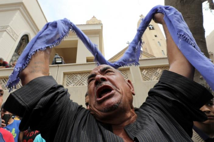 A relative of one of the victims reacts over the attack in Egypt