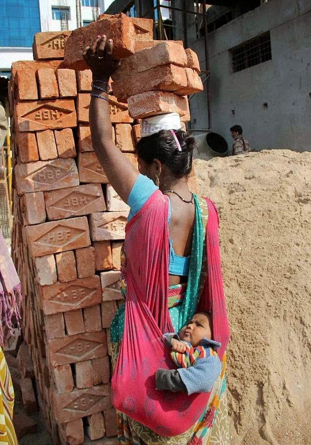 mother india lifted lifting baby bricks