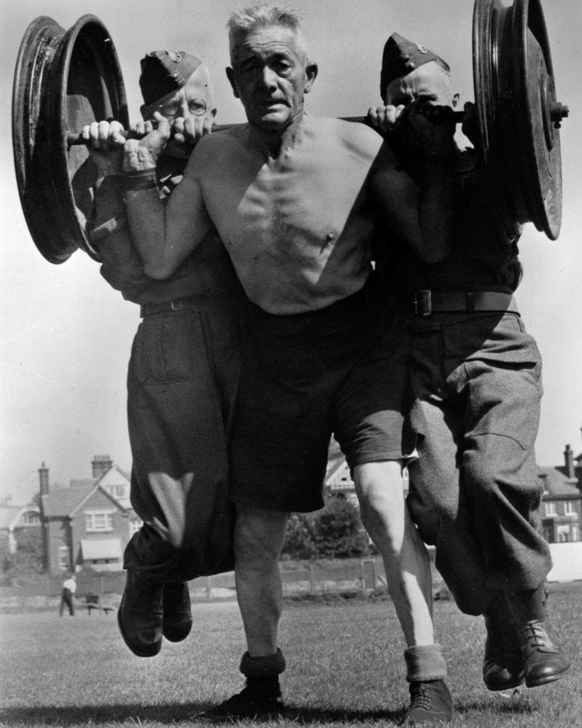 old british soldier lifts lifting heavy